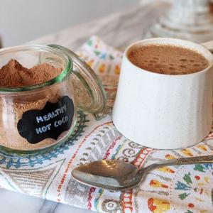 hot chocolate powder and a mug of hot chocolate.