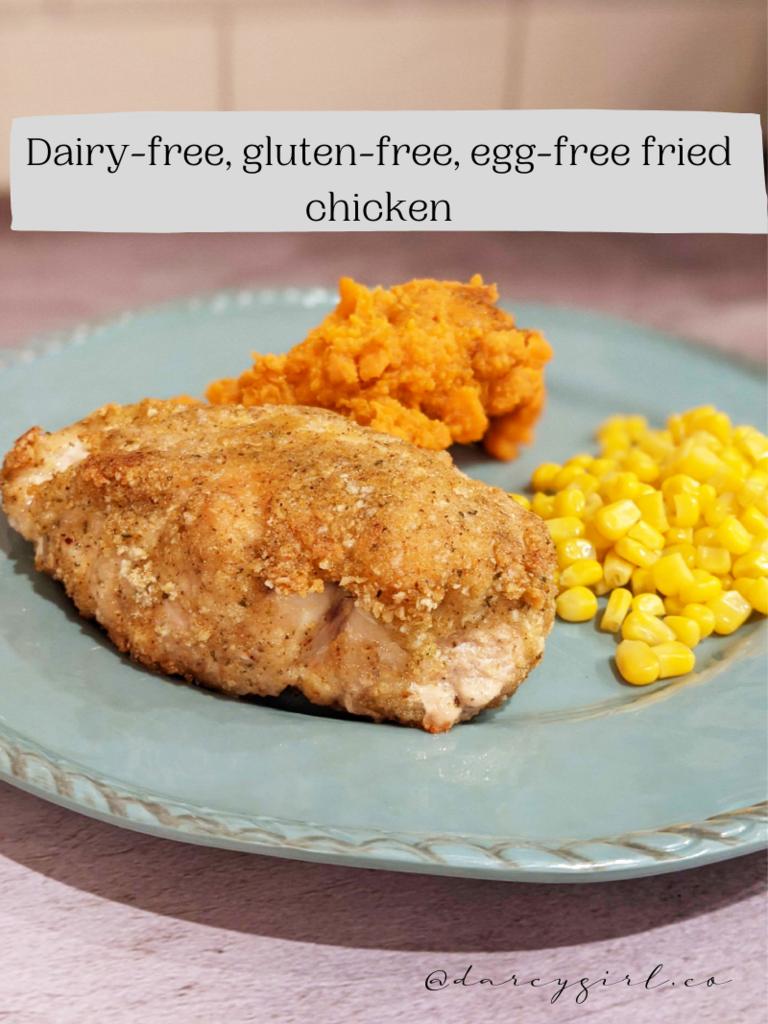 Fried chicken, yams, corn on a plate