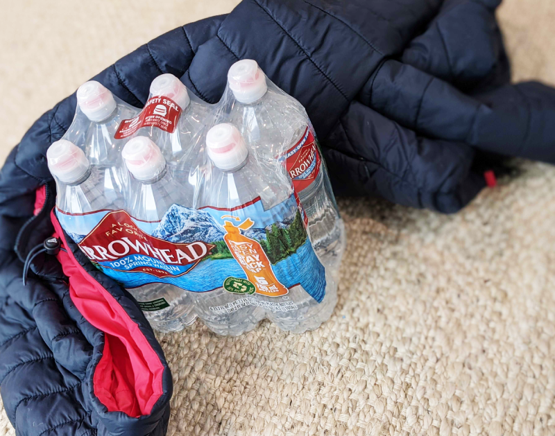 bottled water and a coat