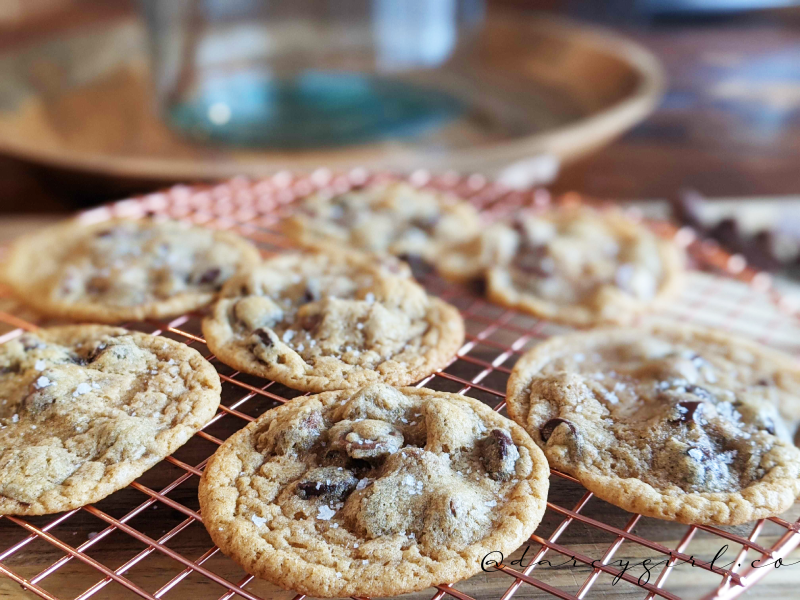 chocolate chip cookies on a wire cooling rack.