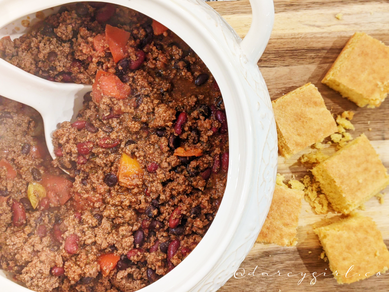 Bowl of chili with cornbread on the side