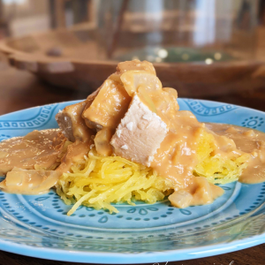 dairy-free pumpkin alfredo over shredded spaghetti square and chicken on top