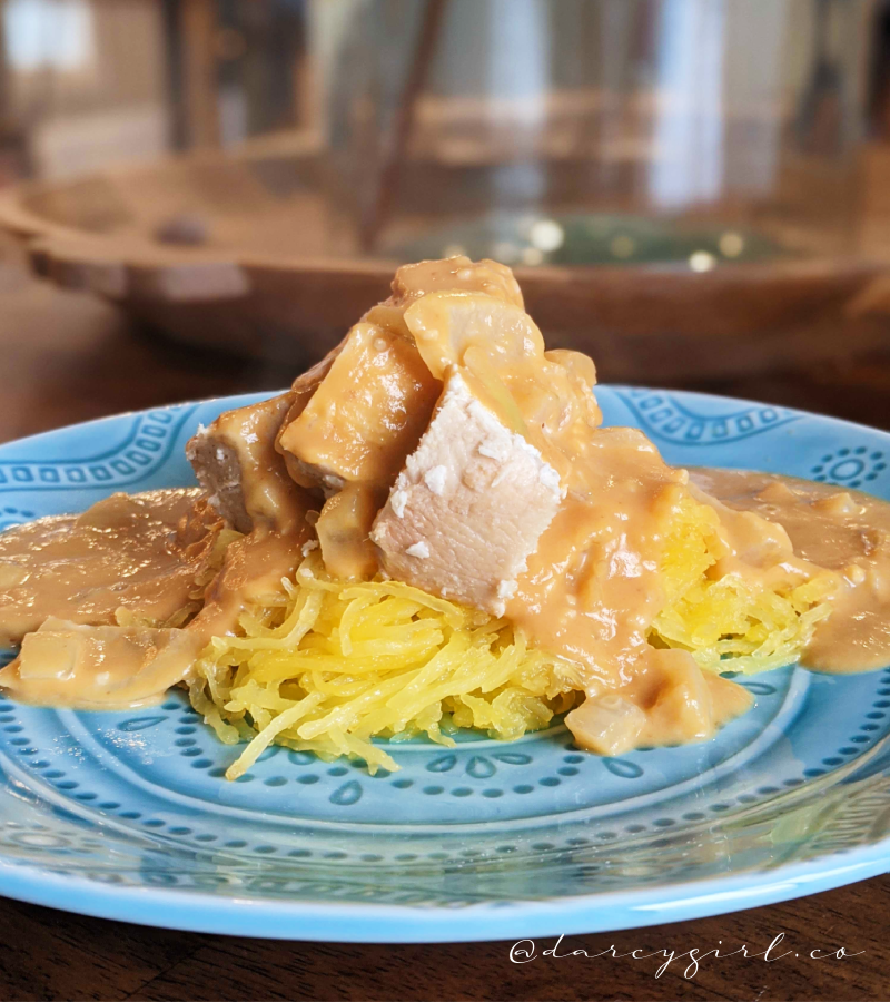 Dairy-free pumpkin alfredo sauce over spaghetti squash noodles and smoked chicken on top.